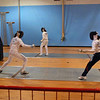 Katharine Holmes (left) and Sarah Collins warm up together before the Cadet Women's Epee.