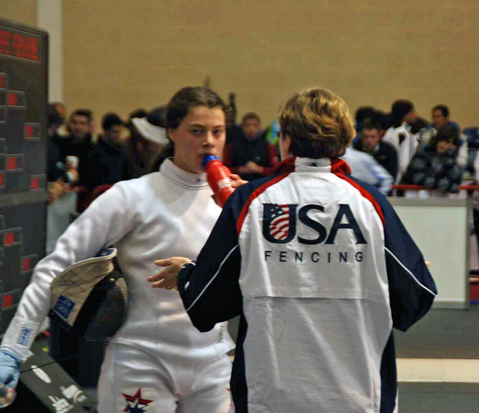 Coach Jean Finkleman instructs Katharine during the 1-minute break.