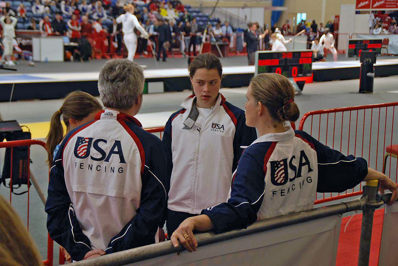 Katharine Holmes consults with the US National Coaches (Ro Sobalvarro, left, and Maureen Griffin).