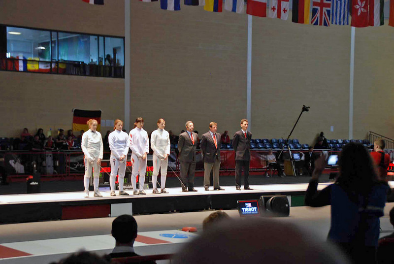 The four semi-finalists and the officials are introduced.