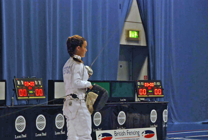 Nina Moiseiwitsch salutes her opponent, Amy Radford, at the start of the gold medal bout of the Cadet Women's Epee British National Championships.