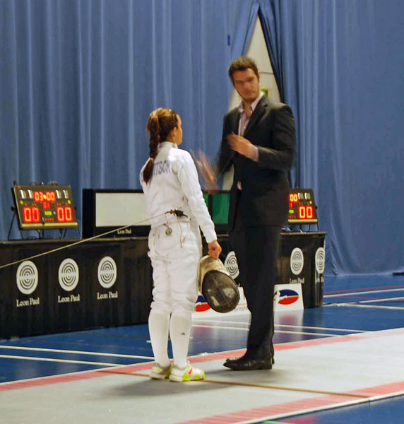 Referee checks Nina Moiseiwitsch's epee before the gold medal bout of the Cadet Women's Epee.