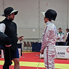 British coach Matt Haynes gives a lesson to one of the men's epee fencers, Daniel Ming.