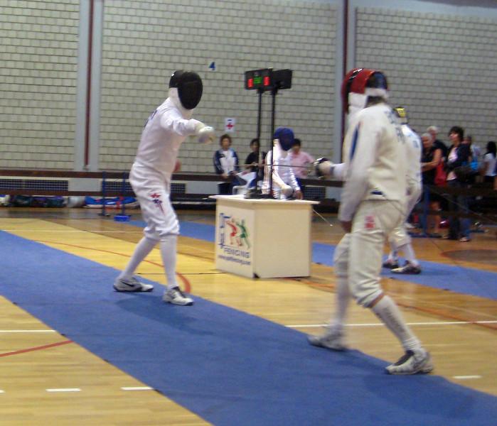 Mark Henry (left) fencing in the 2011 Veteran-70+ Men's Epee World Championships against Jean Paul Boitel (FRA).