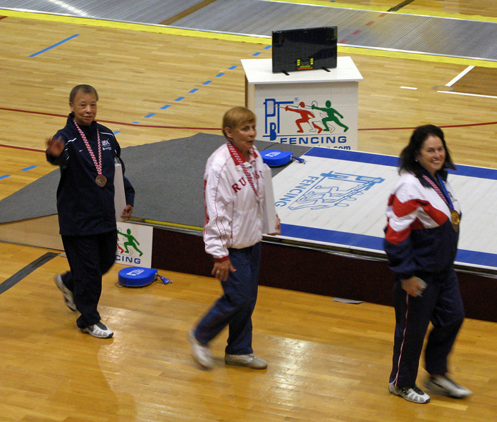 Bettie Graham waves to her US teammates after receiving the Bronze Medal.