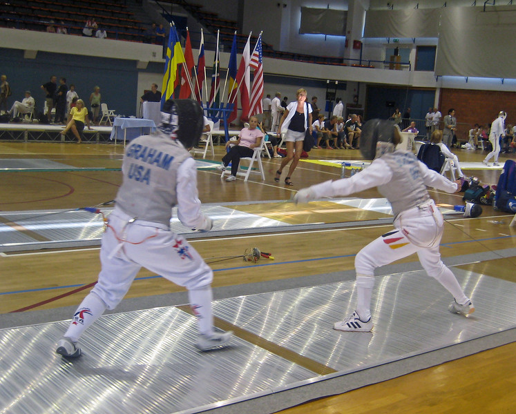 Bettie Graham (left) fencing in the 2011 Veteran-70+ Women's Foil World Championship.