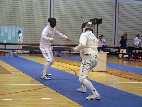 Mark Henry (left) fencing in the 2011 Veteran-70+ Men's Epee World Championships against Roberto Boschetto (ITA).