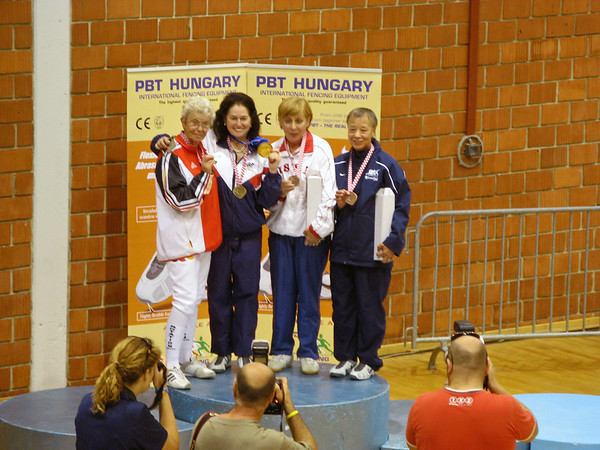 The medalists in the Veteran-70+ Women's Epee World Championships:  Gold Medalist Janet Cooksey (GBR), Silver Medalist Marianne Hempelmann (GER), Bronze Medalists Galina Pshenichkina (RUS) and Bettie Graham (USA).