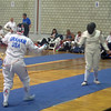 Bettie Graham (left) fences in the Veteran-70+ Women's Epee World Championship against Constance Adam, Great Britain.