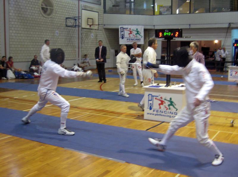 US teammate James Adams (left) fencing against Akira Shinki (JPN).