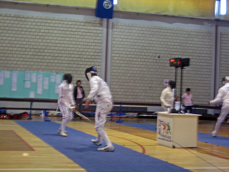 Mark Henry (right) fencing in the 2011 Veteran-70+ Men's Epee World Championships against Nigel Hinchliff (GBR).