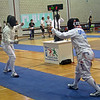 Bettie Graham (right) fences in the Veteran-70+ Women's Epee World Championship.