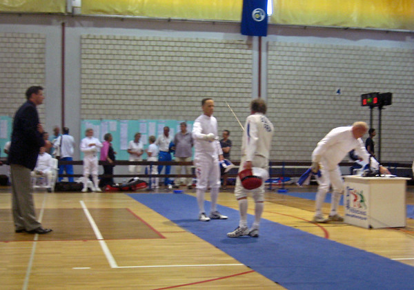 Mark Henry (left) fencing in the 2011 Veteran-70+ Men's Epee World Championships against Jean Paul Boitel (FRA).