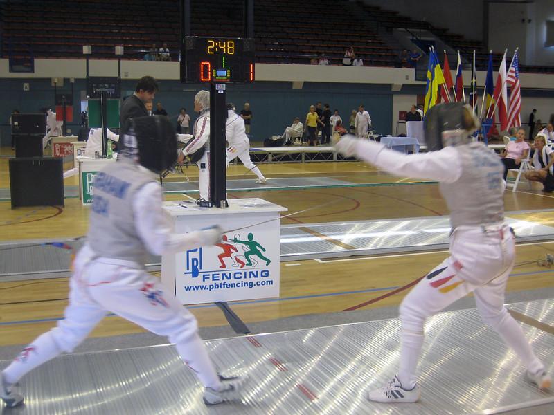 Bettie Graham (left) fencing in the 2011 Veteran-70+ Women's Foil World Championship.