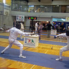 US teammate James Adams (left) fencing against Akira Shinki (JPN).