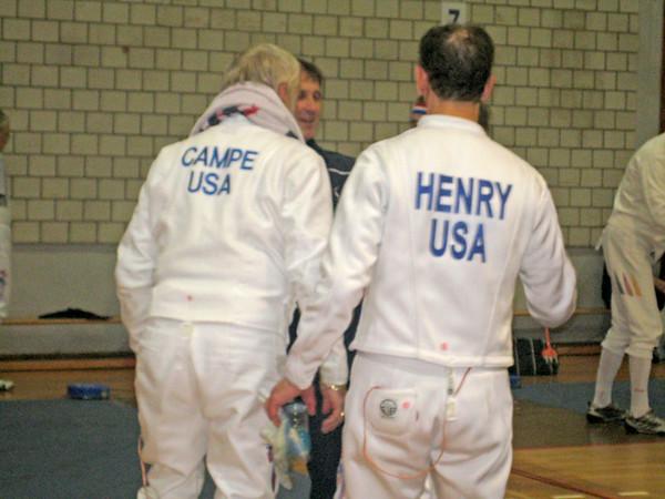US teammates Kaz Campe and Mark Henry talk to US coach Michael Marx.