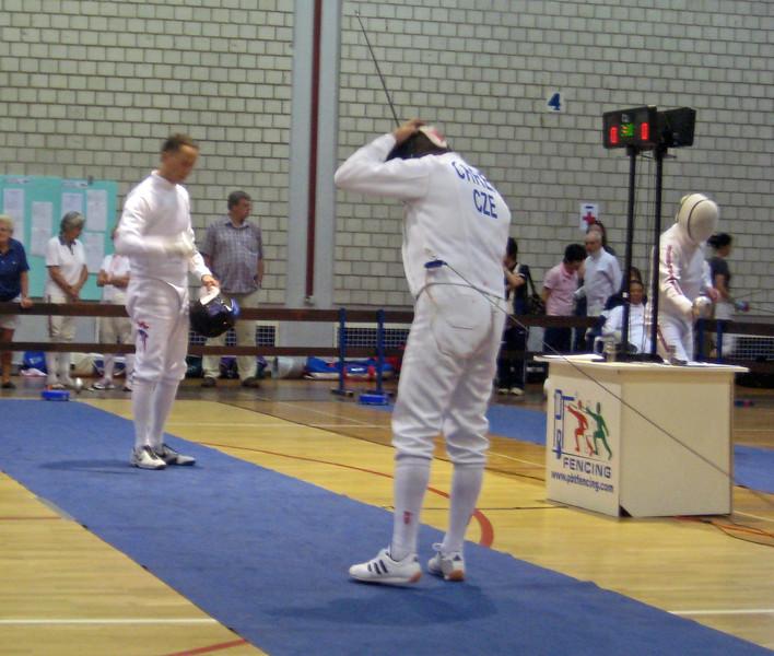 Mark Henry (left) fencing in the 2011 Veteran-70+ Men's Epee World Championships against Dominik Chren (CZE).