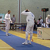 Mark Henry (left) fencing in the 2011 Veteran-70+ Men's Epee World Championships against Dominik Chren (CZE).