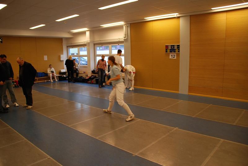 The fencing room at the Bundessportzentrum Südstadt has six metallic strips and scoring machines built into the walls, floor reels under the raised floor.