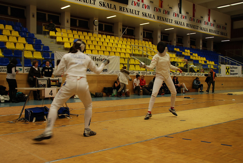 Katharine Holmes (left) fencing in the round of four.