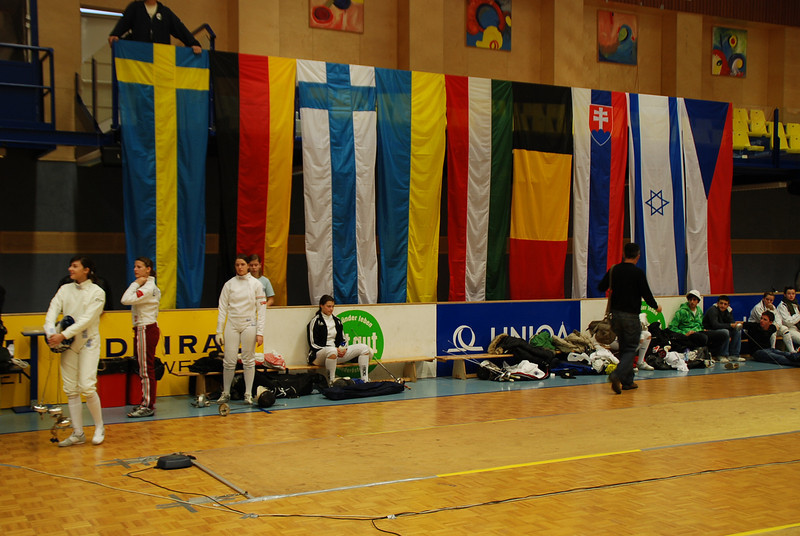 Katharine Holmes, sitting, focuses on her fencing at the Modling tournament.