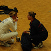 Maureen Griffin coaches her fencer, Grace Neveu, during the 1-minute break in the DE.