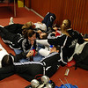 A pile of US fencers relax during the break between rounds in Modling.