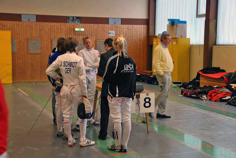 The referee in Annie Stephenson's pool gathers the fencers together before the start of the first round of pools.