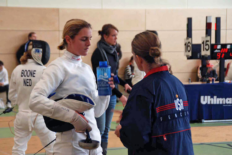 Grace Neveu talks with her coach, Maureen Griffin, during the 1-minute break in the bout.