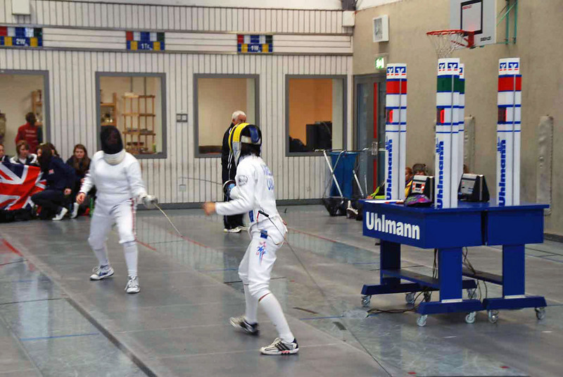 Nik Nik Ameli (right) fencing against Chang from Great Britain in the repechage round.