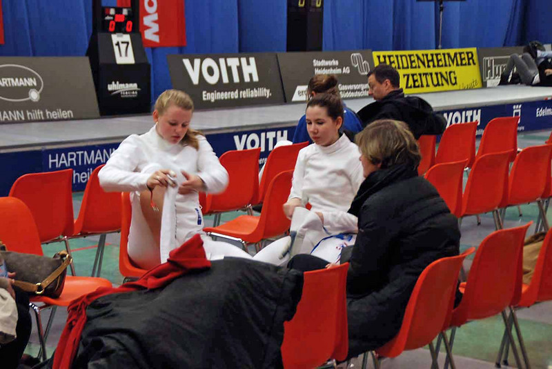 After the final round of pools, Channing Foster (left) and Ashley Severson await to see if they made the next day of fencing (top 64).