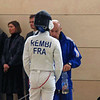 Rembi, a french fencer, consults with her coach.