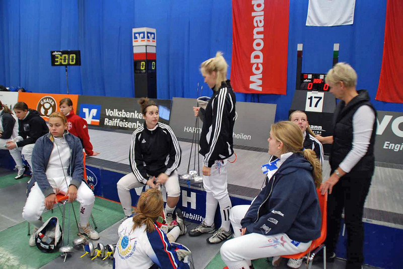 Some of the US fencers waiting for pools to be called.  Annie Stephenson (standing) and Channing Foster (talking to her mom, Lee Foster).