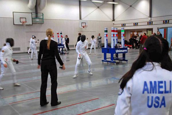 Grace Neveu fencing (right) while Nik Nik Ameli looks on.