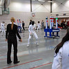 Grace Neveu fencing (right) while Nik Nik Ameli looks on.