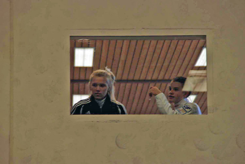 Annie Stephenson (left) and Nina Van Loon look down on the finals room from an upstairs room that had two strips in it.