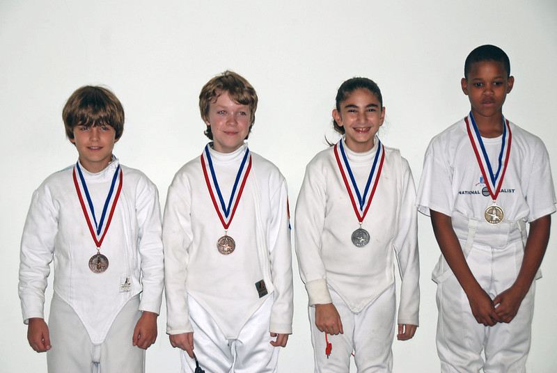 The medalists in the Youth-12 and Under Mixed Epee, Sunday, September 27, 2009, Capitol Division.  From left: Kenneth Hill (3rd), Gianni Cappelletti (3rd), Elizabeth Wiggins (2nd), and Max Robinson (1st).