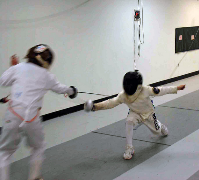 Kenneth Hill (left) in the direct elimination round.