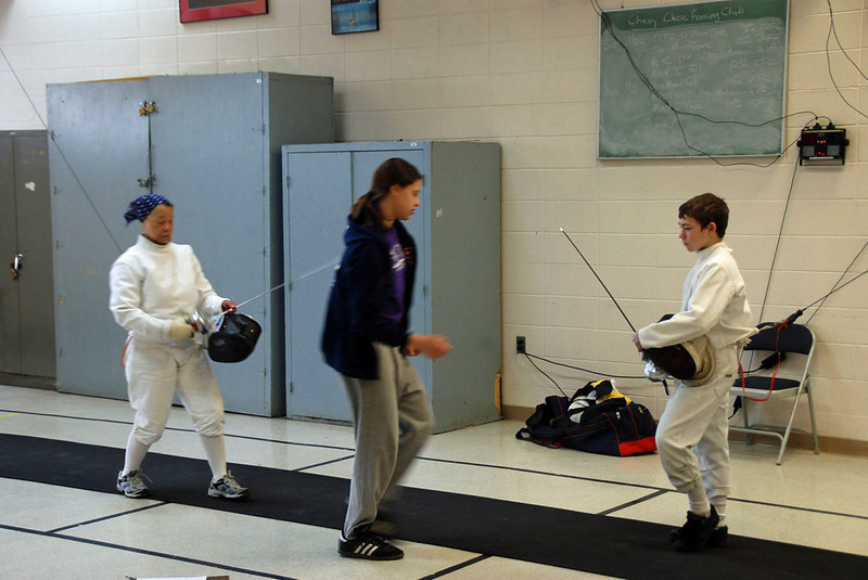 Bettie Graham (left) vs Alex Sax (Katharine Holmes referee).