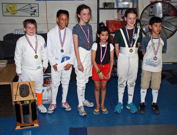 CCFC medal winners in the Youth-10 Mixed Epee are Bryce Knight (2nd place, 2nd from left) and Marc Million (7th place, on right).
