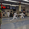 Bryce Knight scores on his opponent in the Youth-10 Mixed Epee.