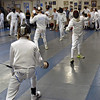Ellis London (right, near strip) and Nicholas McGrew (center strip) compete in the Youth-14 Mixed Epee.