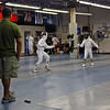 Bryce Knight (left) fencing in the Youth-10 Mixed Epee watched by his brother, Seth Flanagan.