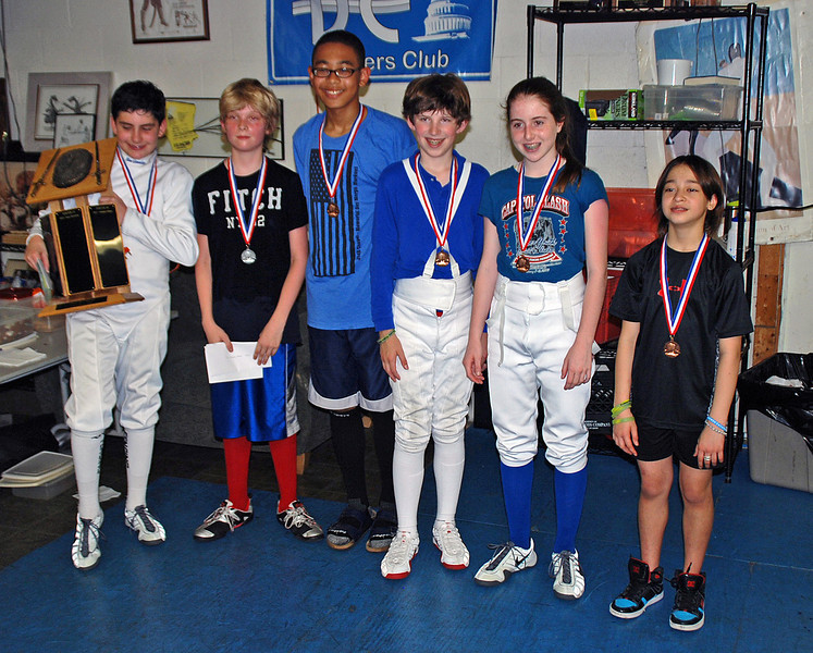 The CCFC medal winners in the Youth-12 Mixed Epee are Levi Freedman (1st place, left), William Foster (3rd place, 4th from left) and Emma Scala (7th place, 5th from left).