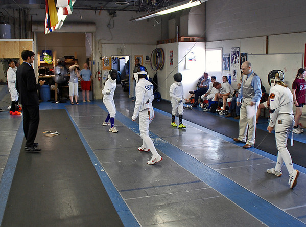 William Foster competes in the quarter-final bout of the Youth-12 Mixed Epee.