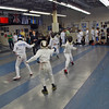 Eitan Jacobsohn (near strip) and William Foster compete in the Youth-12 Mixed Epee.