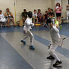 Marc Million (right) competes in the Youth-10 Mixed Epee.