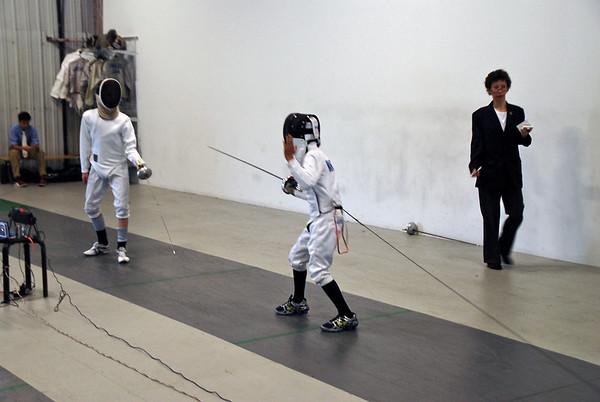 Simon Hardy (left) vs. Alex Wang.