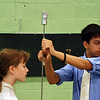 The referee checks Stella Raes' epee.