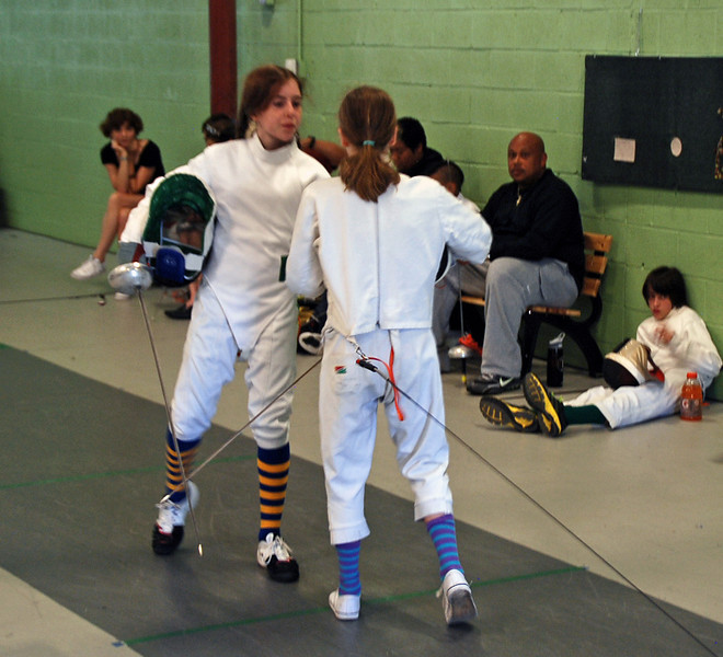 Emma Scala and Stella Raes shake hands after their bout.